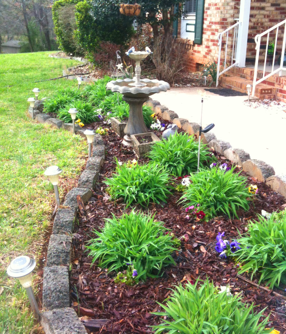 Spring life of bon for Flower bed in front of house